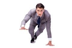 De zakenman op begin klaar voor lopen geïsoleerd op wit stock afbeelding