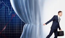 De zakenman opent het programma van succes Stock Afbeelding