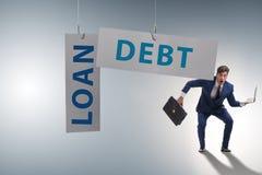 De zakenman in schuld en leningsconcept stock foto