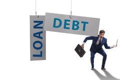 De zakenman in schuld en leningsconcept stock foto's