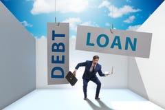 De zakenman in schuld en leningsconcept stock fotografie