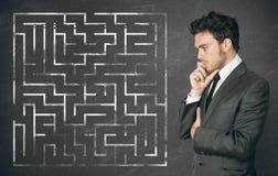 De zakenman streeft naar de oplossing Stock Afbeelding