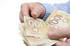 De zakenman telt geld Stock Foto