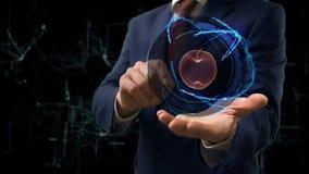 De zakenman toont conceptenhologram 3d appel op zijn hand stock videobeelden