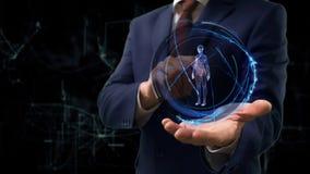 De zakenman toont conceptenhologram 3d vrouw op zijn hand stock foto's