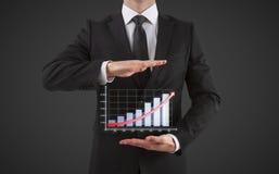 De zakenman toont grafiek Royalty-vrije Stock Afbeeldingen