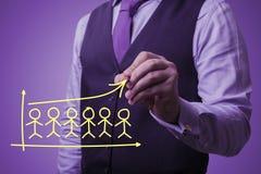 De zakenman trekt pictogrammen van mensen Stock Foto