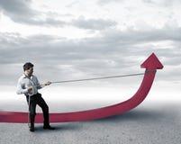 De zakenman verandert statistieken Stock Foto's