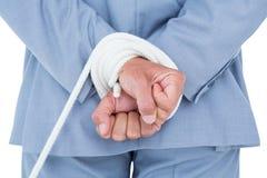 De zakenman verbond in kabel Stock Afbeelding