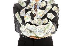 De zakenman verdient ons dollar met geldregen Royalty-vrije Stock Foto