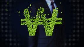 De zakenman wat betreft groen die blad WON geld, muntteken, van bladeren wordt gemaakt stock footage