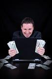 De zakenman wordt verdiend het geld stock foto