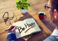 De zakenman Writing de Woorden Gelukkig is stock afbeeldingen