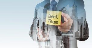 De zakenmanhand toont beste teamwoorden Stock Afbeeldingen