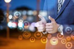 De zakenmanhand toont goed op een donkere achtergrond Royalty-vrije Stock Afbeelding