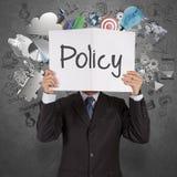 De zakenmanhand toont tekstboek beleid royalty-vrije stock afbeelding