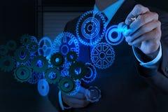 De zakenmanhand trekt toestel aan succes stock afbeeldingen