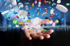 De zakenmanholding en wat betreft drijvende 3D geneeskundepillen trekt uit Stock Fotografie