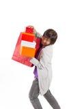 De zakken van de dameholding en giftdoos met gelukkige actie, volledige lengte po Stock Afbeelding