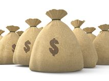 De zakken van het geld stock afbeeldingen