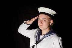 De zeeman van de marine het groeten op zwarte Stock Afbeeldingen