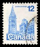 De zegel in Canada wordt gedrukt toont Parlementsgebouwen dat royalty-vrije stock afbeeldingen