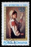 De zegel die door Roemenië wordt gedrukt, toont beeld` Vrouw die ` spinnen door Nicolae Grigoresky stock foto's