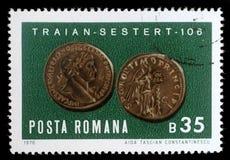 De zegel die door Roemenië wordt gedrukt, toont het kopersestertius van Keizertrajans stock fotografie