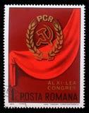 De zegel die in Roemenië wordt gedrukt toont 11de Roemeens Communistisch Partijcongres Stock Fotografie