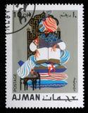 De zegel door Ajman wordt gedrukt toont Oosterse sprookjes dat stock foto