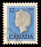 De zegel door Canada wordt gedrukt, toont Koningin Elizabeth II die royalty-vrije stock foto