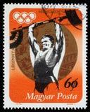 De zegel in Hongarije wordt gedrukt, toont Gewichtheffen en Gouden medaille die Stock Afbeeldingen