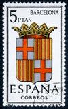 De zegel in Spanje gewijd aan Wapens van Provinciale Kapitalen wordt gedrukt toont Barcelona dat royalty-vrije stock foto