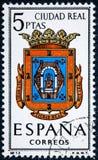 De zegel in Spanje gewijd aan Wapens van Provinciale Kapitalen wordt gedrukt toont Ciudad Real dat royalty-vrije stock afbeelding