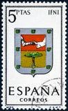 De zegel in Spanje gewijd aan Wapens van Provinciale Kapitalen wordt gedrukt toont Ifni die stock fotografie