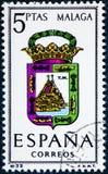 De zegel in Spanje gewijd aan Wapens van Provinciale Kapitalen wordt gedrukt toont Malaga dat stock foto's