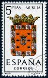 De zegel in Spanje gewijd aan Wapens van Provinciale Kapitalen wordt gedrukt toont Murcia dat royalty-vrije stock foto's