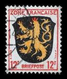 De zegel in de Streek Francaise, Duitsland wordt gedrukt toont Wapenschild van Palatinaatdistrict dat royalty-vrije stock foto's