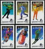 De zegels in Hongarije worden gedrukt tonen de Winterolympics van 1988, Calgary dat Stock Afbeelding