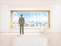 De zetel en de grafiek van het zakenmanvenster Royalty-vrije Stock Afbeelding