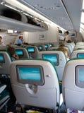 De zetels van het vliegtuig met het TVscherm Royalty-vrije Stock Afbeeldingen