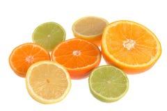 De zeven helften van sinaasappel, minneola, mandarin, kalk en citroenisola Royalty-vrije Stock Fotografie