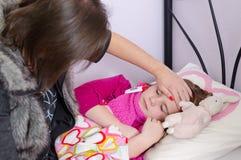 De ziekteperiode van het kind Stock Foto