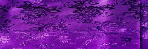de zijde donkere sering van de achtergrondtextuurstof met een patroon met Th Stock Foto