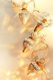 De zilveren en Gouden Ornamenten van Kerstmis Stock Afbeeldingen