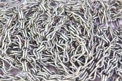 De zilveren textuur van staalkettingen als achtergrond Royalty-vrije Stock Foto's