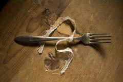 De zilveren vork bond lint vast Stock Foto's