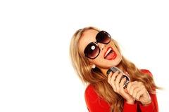 De zingende Microfoon van de Holding van de Blonde stock foto
