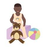 De zitting van de babyjongen op de speelgoeddoos Stock Afbeeldingen