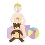 De zitting van de babyjongen op de speelgoeddoos Royalty-vrije Stock Afbeeldingen